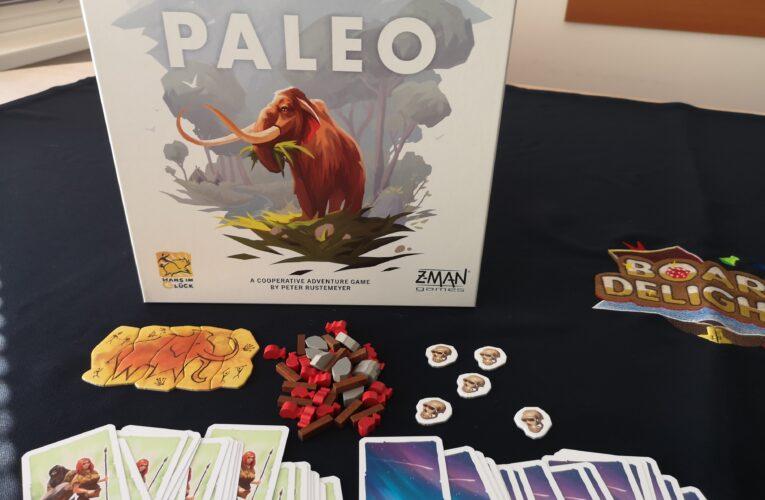 """Предна корица и компоненти от настолната игра """"Paleo"""""""